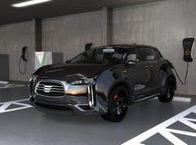 Black electric SUV recharging in parking garage Royalty Free Stock Image