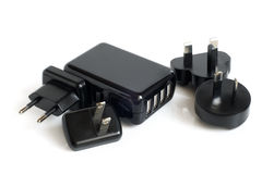 Black electrical adapters to USB port Stock Images