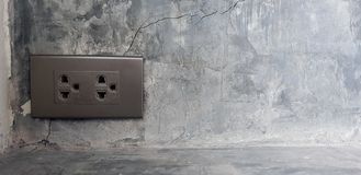 Black electrical outlet on the wall, Home interior electrical outlet,Copy space for texture and background.  royalty free stock images