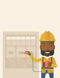 Black electrician repairing an electrical panel Royalty Free Stock Image