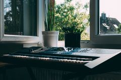 Black Electronic Keyboard Near Window Royalty Free Stock Photo