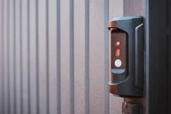Black electronic lock with sound transmission capability. Metal gates locked and blurred by photographer stock photos