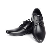The black elegant men's shoes on white isolated background Royalty Free Stock Photos