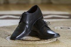 Black elegant shoes on the carpet Stock Photo