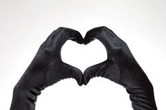 Black elegant women's heart shaped gloves isolated on white background Royalty Free Stock Photography