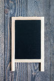 Black empty chalkboard on wooden table for copy space Stock Photo