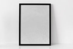 Black empty frame with shadow. In natural light on reflective surface Stock Images