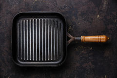 Black empty grill pan on dark background Stock Images