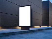 Black empty lightbox on the street. Wooden facades Royalty Free Stock Photography