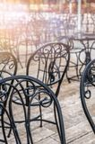 Metal chairs outside restaurant in summer royalty free stock images