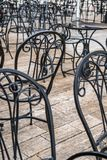 Metal chairs outside restaurant in summer stock photography