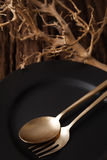 Black empty plate fork spoon on wooden table background Stock Image