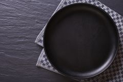 Black empty plate on the table. top view horizontal Stock Image