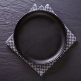 Black empty plate on the table. top view Royalty Free Stock Images