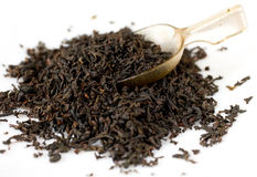 Black english tea with tea spoon. White background Stock Image