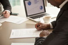 Black entrepreneur concluding agreement at meeting Royalty Free Stock Photos