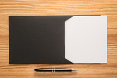 Black envelope with white paper and pen Stock Image