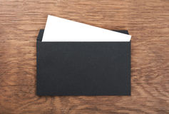 Black envelope on  wooden table Royalty Free Stock Photography