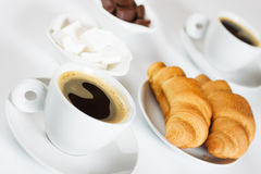 Black espresso coffee with croissants Royalty Free Stock Photos