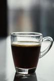 Black espresso coffee with heady froth in a glass mug or cup Royalty Free Stock Images