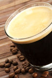 Black espresso coffee in a short glass with coffee Royalty Free Stock Image
