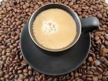 Black Espresso Cup and Whole Coffee Beans Royalty Free Stock Photos