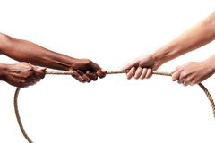 Black ethnicity arms with hands pulling rope against white Caucasian race person in stop racism and xenophobia concept. Immigration and multiracial respect royalty free stock images