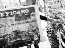 Black ethnicity man buys press reporting handover ceremony presi. PARIS, FRANCE - MAY 15, 2017: Le Figaro newspaper with black ethnicity man buying newspaper stock photo
