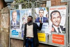 Black ethnicity man showing support to Emmanuel Macron. STRASBOURG, FRANCE - APR 23, 2017: Black ethnicity man showing his support to Emmanuel Macron near all 11 Stock Image