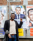 Black ethnicity man showing support to Emmanuel Macron Royalty Free Stock Images