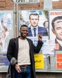 Black ethnicity man showing support to Emmanuel Macron. STRASBOURG, FRANCE - APR 23, 2017: Black ethnicity man showing his support to Emmanuel Macron near all 11 Royalty Free Stock Images