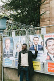 Black ethnicity man showing support to Emmanuel Macron Royalty Free Stock Photo