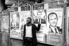 Black ethnicity man showing support to Emmanuel Macron. STRASBOURG, FRANCE - APR 23, 2017: Black ethnicity man showing his support to Emmanuel Macron near all 11 Stock Images