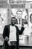Black ethnicity man showing support to Emmanuel Macron. STRASBOURG, FRANCE - APR 23, 2017: Black ethnicity man showing his support to Emmanuel Macron near all 11 Royalty Free Stock Image