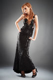 Black Evening Dress. Red haired woman in long black evening dress Royalty Free Stock Images