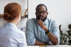 Black executive manager interviewing female for company position stock photography