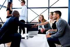 Black executive shaking hands with female colleague royalty free stock photography