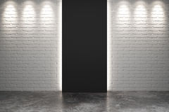 Black exit in empty room with brick walls and concrete floor. Close up Royalty Free Stock Photos