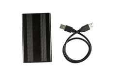 Black external hard disk drive with USB cable.  Royalty Free Stock Images