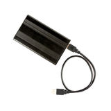 Black external hard disk drive with USB cable.  Stock Images