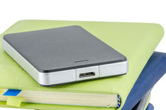 Black External Hard Disk on stack of diary Royalty Free Stock Image