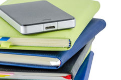 Black External Hard Disk on stack of diary Royalty Free Stock Images
