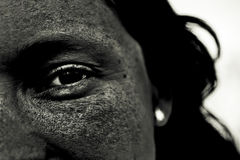 Black eye. In black face staring at you royalty free stock photography
