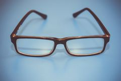 Black Eye Glasses on a blue background. Stylish setting. Black Eye Glasses . Stylish setting Stock Images