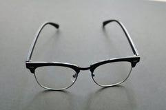 Black Eye Glasses,Vintage Glasses on gray background.  royalty free stock images