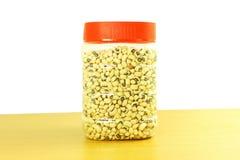 Black eye peas beans in jar in white background Stock Photos