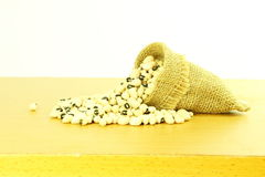 Black eye peas beans in jute bag in white background Stock Photography