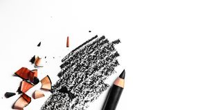 Black eye pencil stroke close-up isolated on white background. Beauty texture, cosmetic product and art of make-up concept - Black eye pencil stroke close-up royalty free stock photo