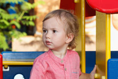 Black eyed children playing outside playground, peculiar kid in park, happy childhood. Royalty Free Stock Photos