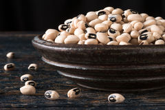 Black Eyed Pea. Dried Black Eyed Peas in a pottery bowl Royalty Free Stock Photos